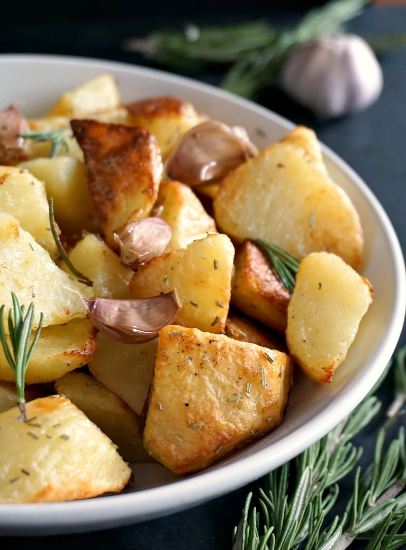 Close-up shot of a whilte plae with roasted potatoes