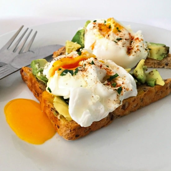 2 slices of bread topped with poached egs and avocado
