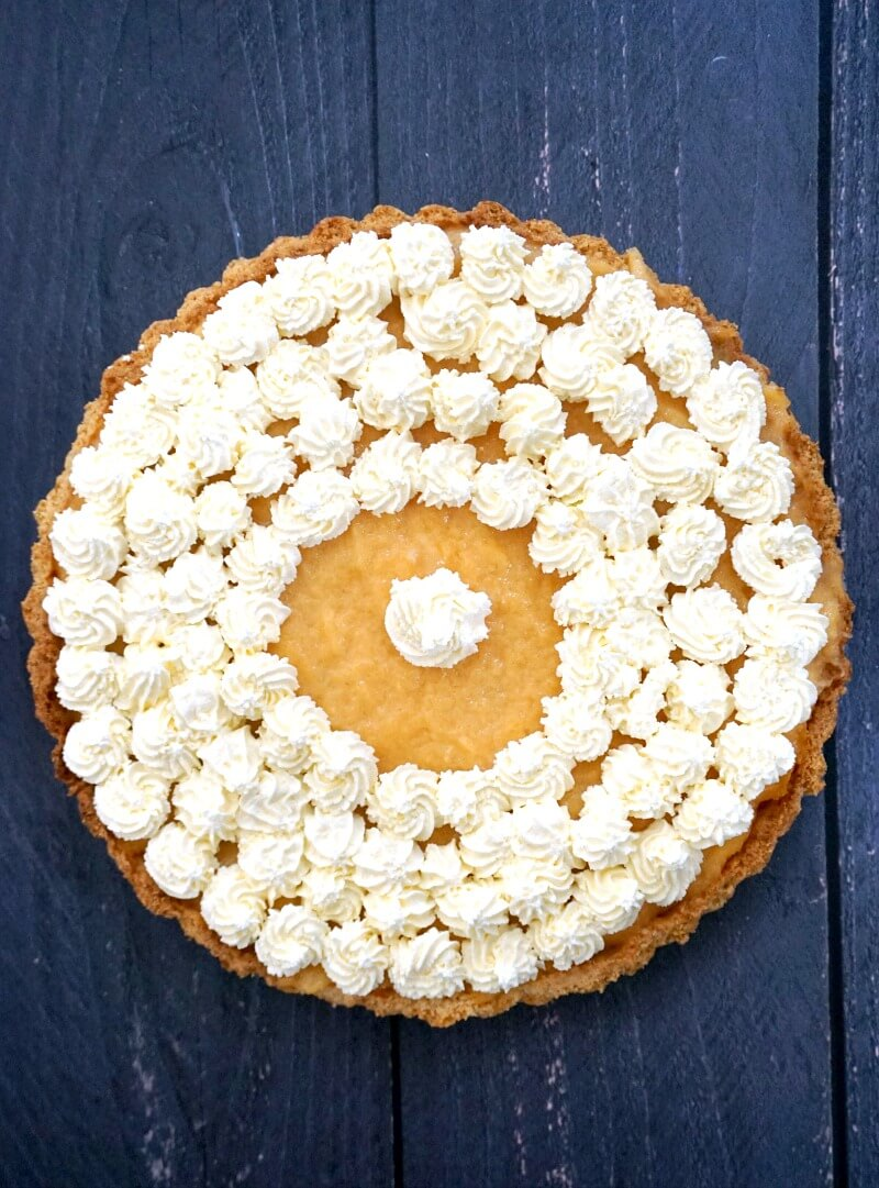 Overhead shoot of a cantaloupe pie decorated with whipped cream