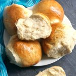 Fluffy Dinner Rolls made from scratch, so soft and easy to make at home with just a few simple ingredients. These bread rolls are the best you can get, they are so light and pillowy, you won't believe you've made them with so little effort and preparation. It might be a small batch, but so delicious! These dinner rolls will quickly become a sample food in your house when it's a big celebration, or just everyday dinner. #dinnerrolls, #breadrolls, #sidedish, #easter, #bread