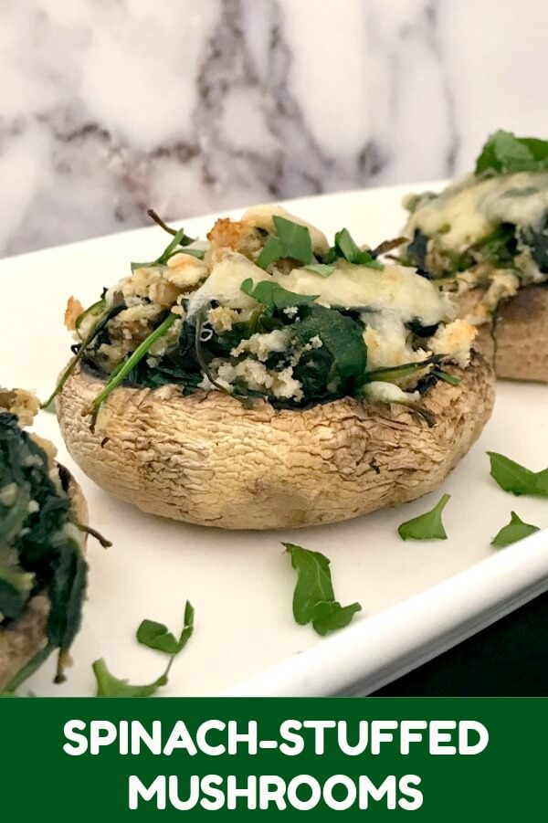 Spinach-Stuffed Mushrooms, a fantastic vegetarian appetizer that will be the star of any party. Healthy, ridiculously easy to make, low calorie, and so delicious, these mushrooms are sure to please a crowd.
