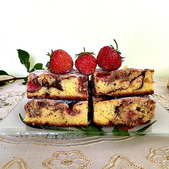 4 Slices of chocolate marble cake with 3 strawberries on top