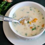 "Chicken soup with garlic and sour cream or the Romanian ""Ciorba Radauteana"" makes a great natural remedy agaist cold and flu. An easy healthy soup that will become a family favourite."