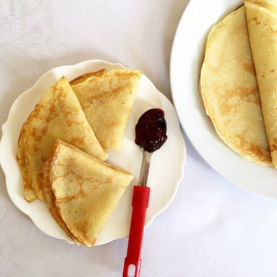 Overshoot of a white plate with 3 folded french crepes