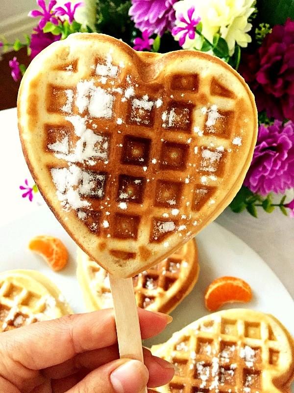 A cinnamon waffle on a stick