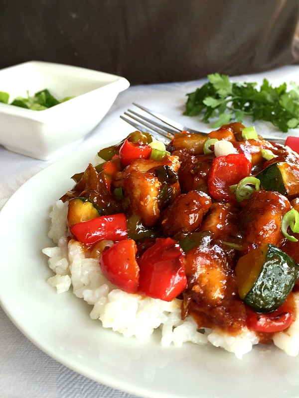 A plate with sweet and sour chicken and vgetables