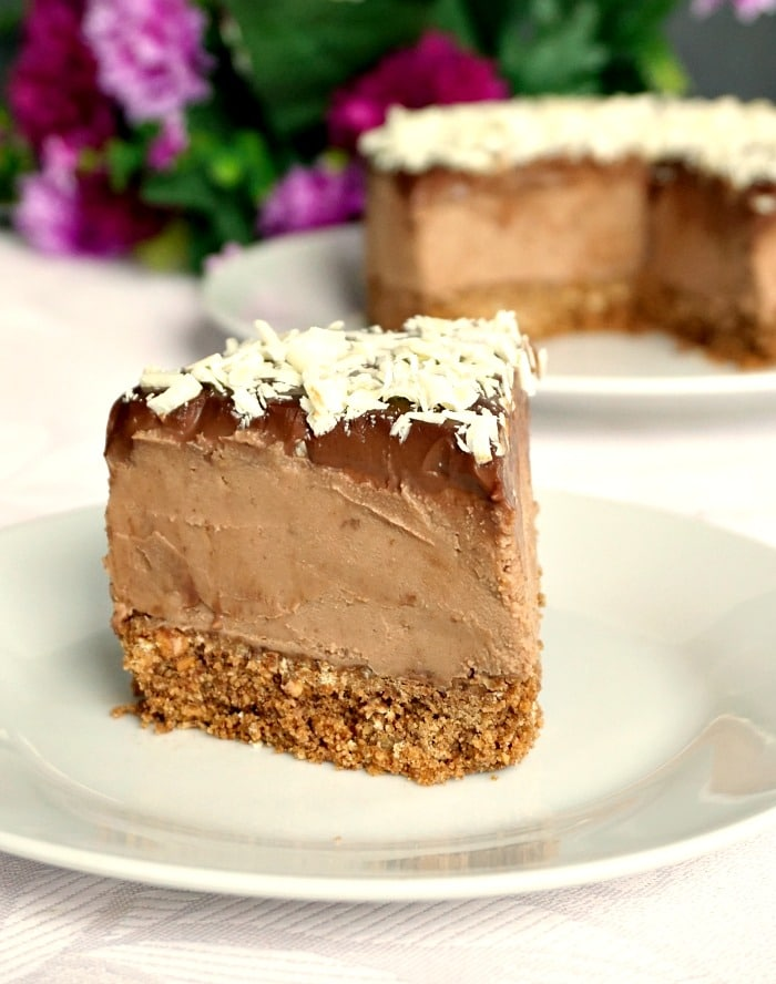 A slice of Triple Chocolate Mascarpone Cheesecake on a white plate