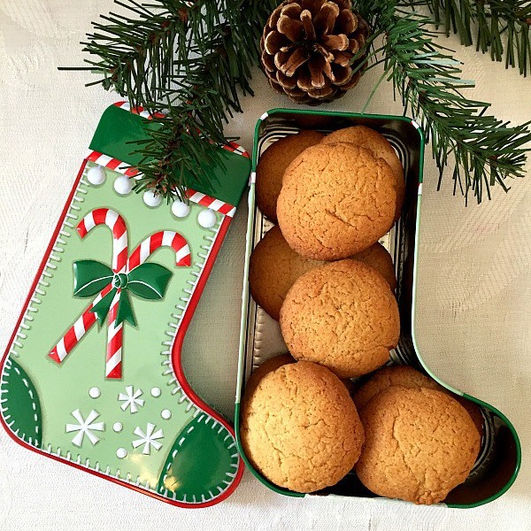 A box of gingersnaps near a Christmas tree
