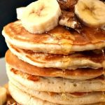 Jamie Oliver's Fluffy American Pancakes topped with walnuts and bananas, and a good squeeze of honey, an indulgent yet healthy breakfast or brunch for kids and grown-ups too. This is a quick and easy recipe that will go down a treat every single time. All you need for these pancakes are a few simple ingredients that you can measure with cups and teaspoons, no need for fancy kitchen equipment. My American pancakes do not habe any added sugar. #americanpancakes, #jamieoliver, #breakfast, #brunch