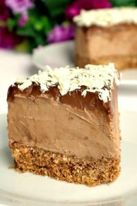 No-Bake Triple Chocolate Mascarpone Cheesecake, a rich and overly-indulgent dessert that screams perfection. The sweetest treat for any party or celebration, this cheesecake is super easy to make and so delicious.It has one layer of digestive biscuits and cocoa powder, another layer of a velvety milk chocolate and mascarpone cream, then topped with dark chocolate and grated white chocolate. The best homemade dessert! #triplechocolatecheesecake, #cheesecake, #mascarpone, #dessert, #npbakedessert