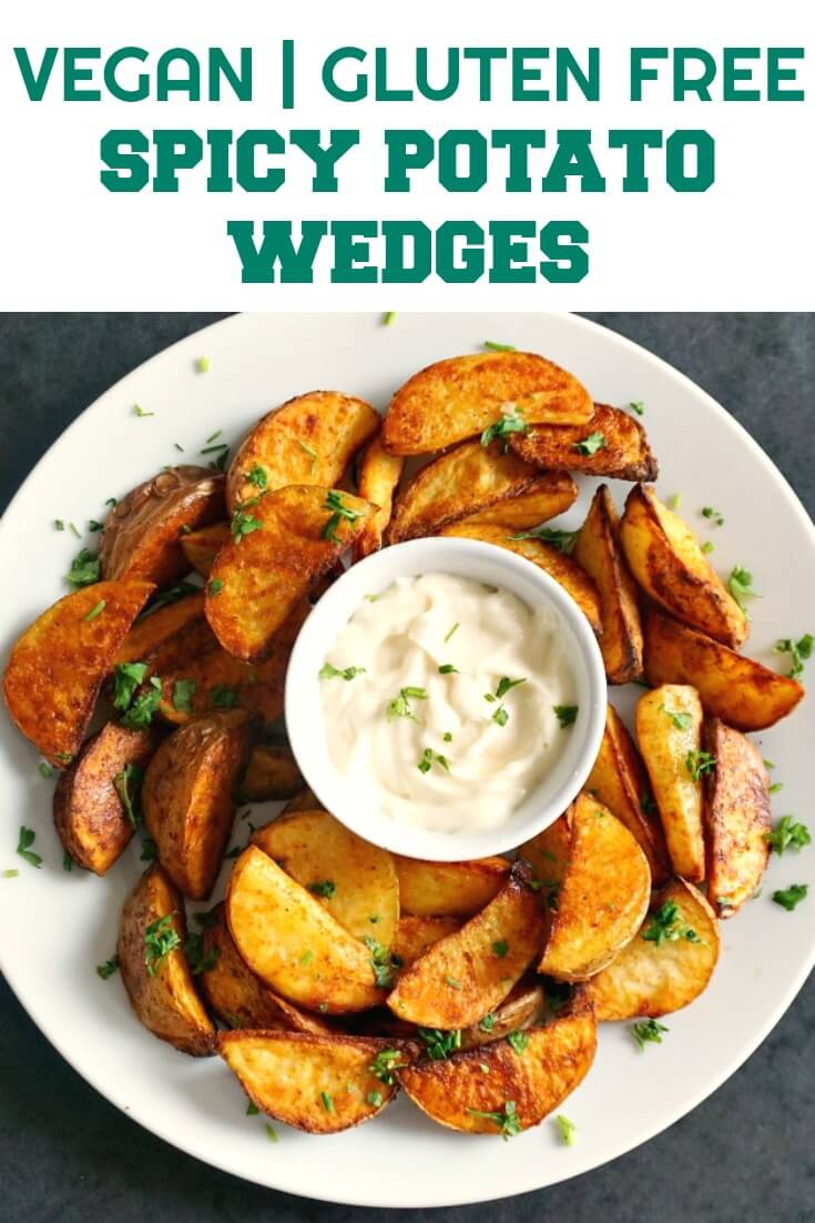 Homemade Spicy Potato Wedges, the best side dish that goes wonderfully well with any roast, burgers, meat sandwiches or wraps, or just on their own.  Serve them with your choice of sauce, and you are in for a treat. No need to order a take-away,  have your own feast at home, they are just amazing. Great choice for the Game Day, or just a nice meal. Vegan, gluten free.