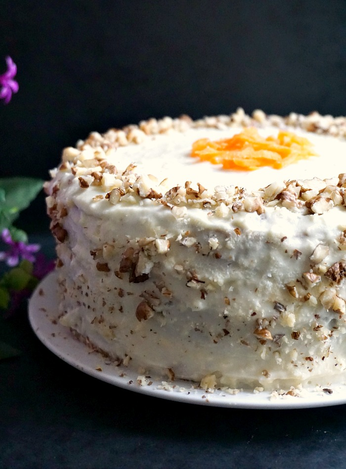 Super moist carrot cake on a white plate