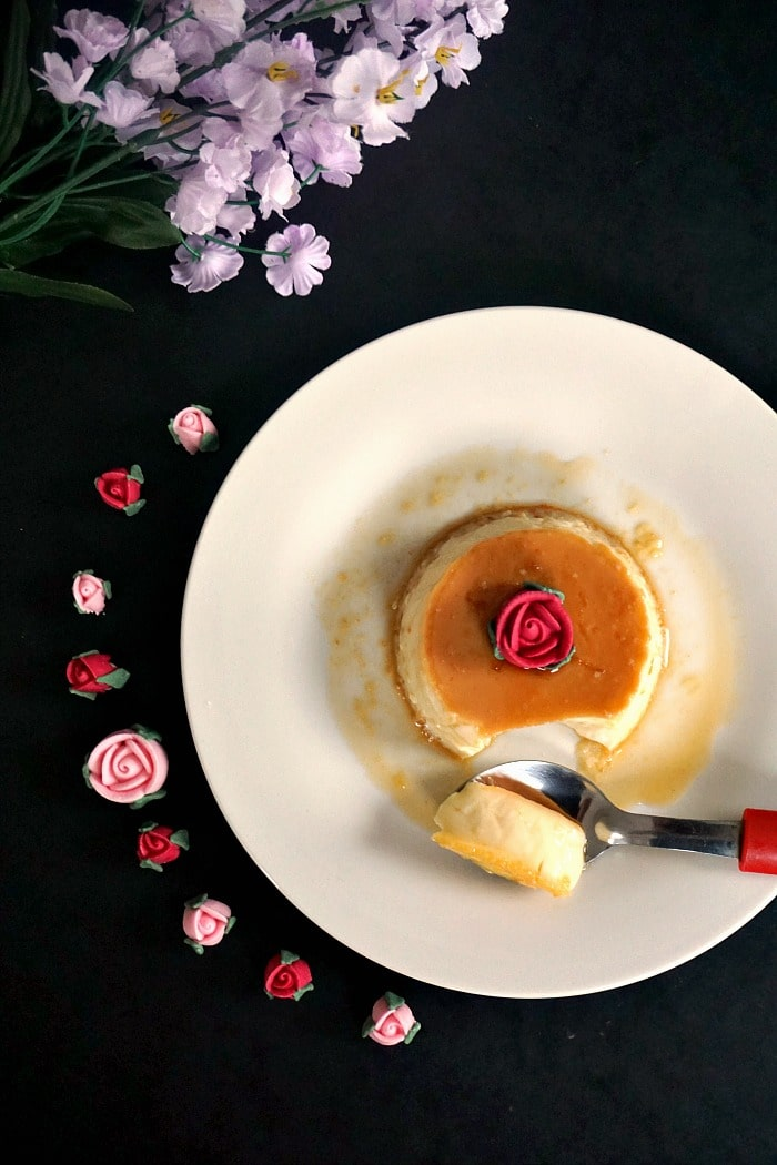 Overhead shoot of a flan dessert on a white plate