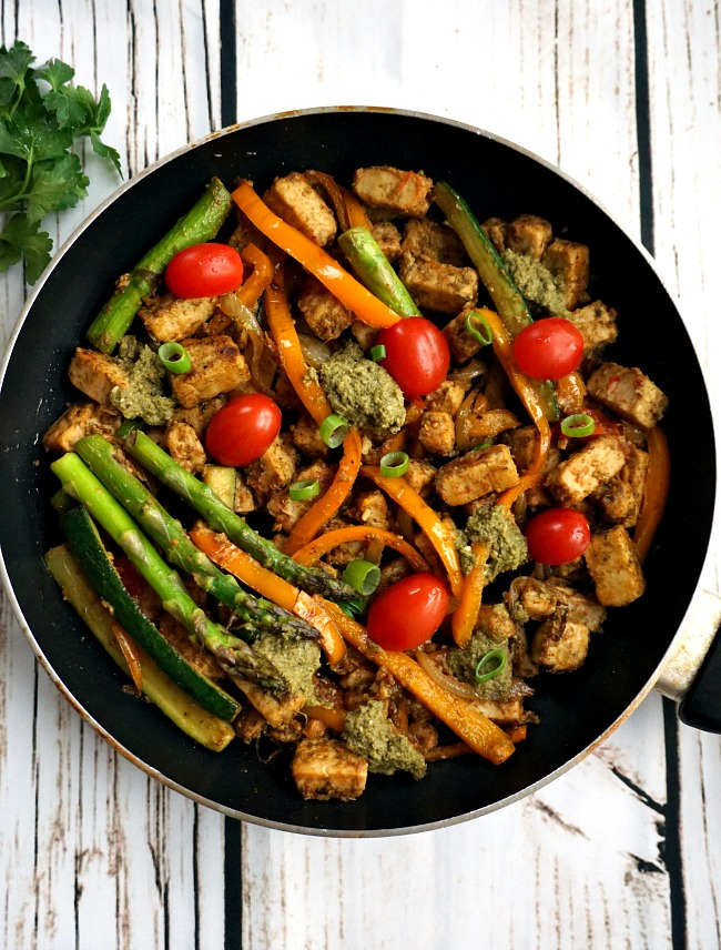 Overhead shot of a black frying pan with quorn chicken pieces and vegetables
