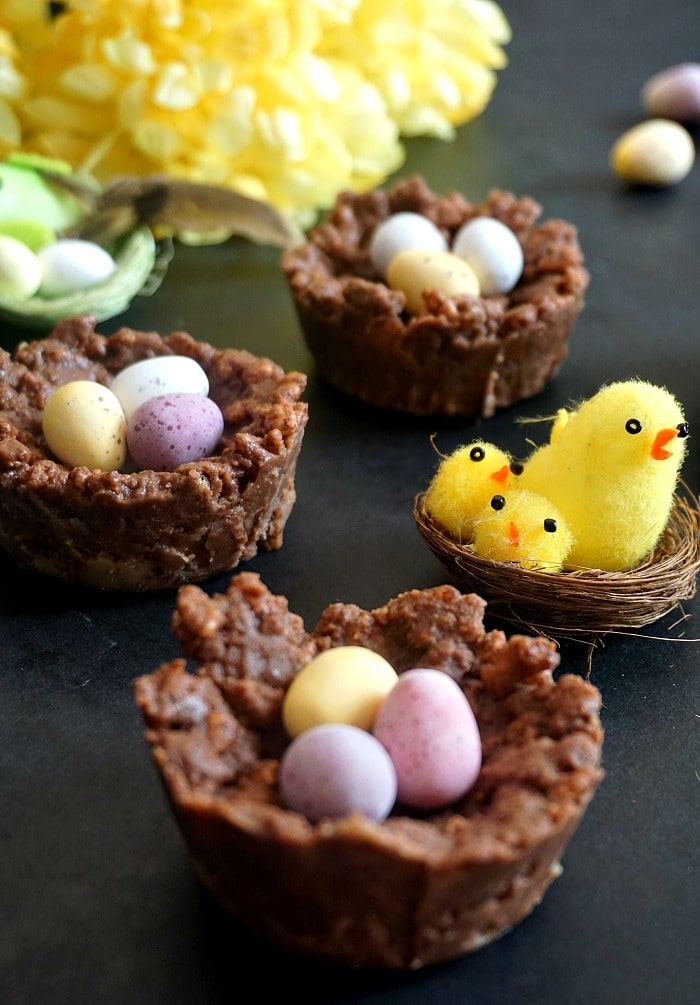 3 Rice krispies Easter nests filled with mini chocolate eggs and a bird nest