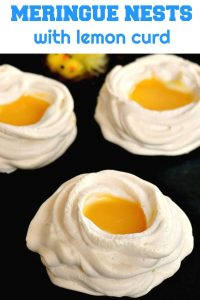 Meringue nests with lemon curd, a fantastic treat for your Easter dessert menu. Nothing beats a homemade lemon curd and some scrumptious meringue nests that are crunchy on the outside, but soft and chewy on the inside.