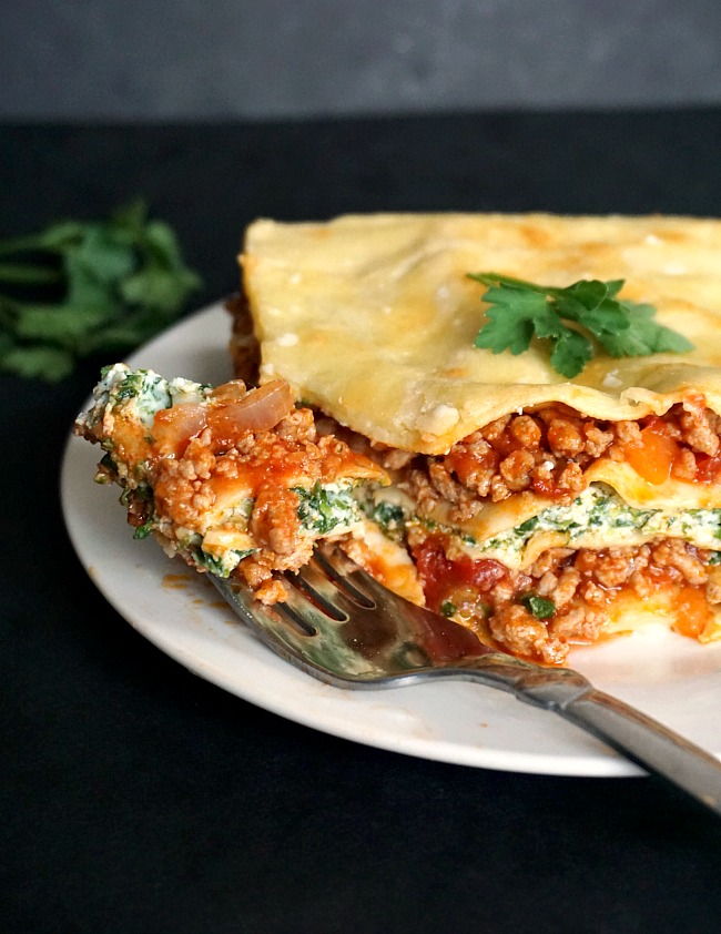 A generous slice of turkey lasagna on a white plate