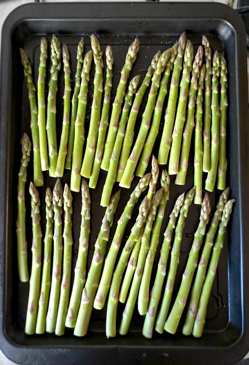 Overhead shoot of a baking tray with asparagus tips