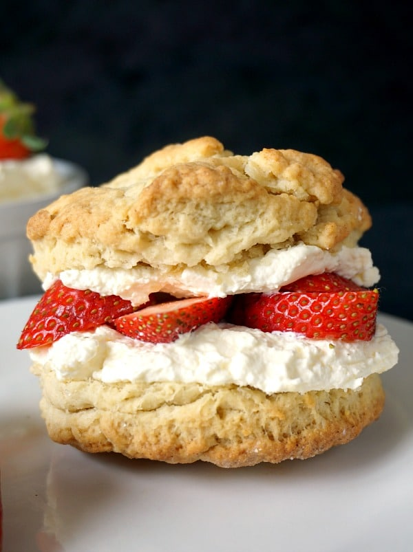 A shortcake biscuit with strawberries and cream