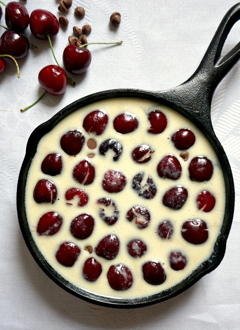 Overhead shot of a skillet with uncooked cherry clafoutis