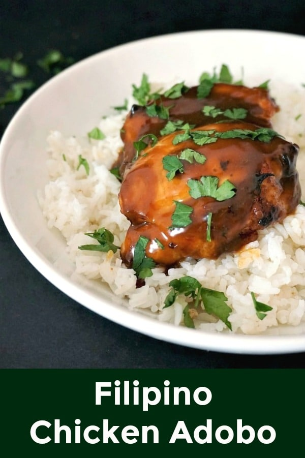 Filipino Chicken Adobo, a delightful dish served with basmati rice and plenty of freshly-chopped parsley. A great dinner recipe that will please everyone. Healthy, flavourful, and easy to make.