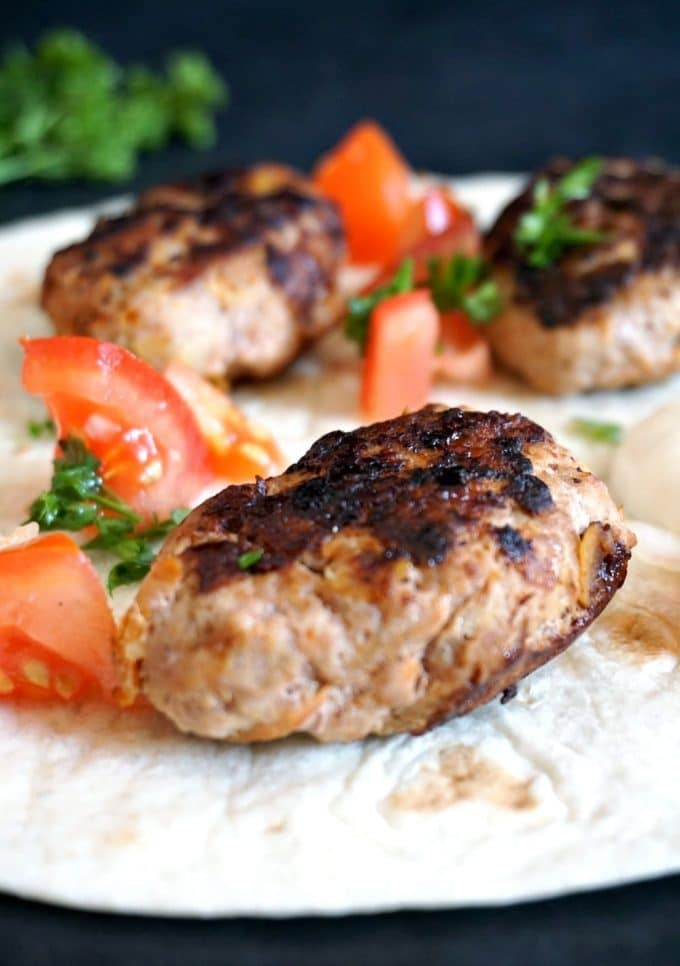 Turkey kofta with tomato onion salad on a tortilla wrap