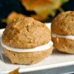 2 pumpkin whoopie pies on a white plate