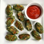 Healthy baked Brussels sprout cheese spinach bites served with ketchup, a delightful finger food for any age