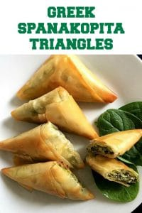 Greek Spanakopita Triangles or feta and spinach pies, a fantastic appetizer or healthy snack and can be enjoyed either warm or cold. Learn how to fold the phyllo dough to perfection and impress all your guests with these fabulous bites.