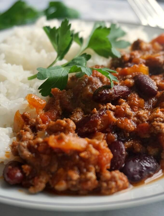 Close-up shot of a plate with rice and the best homemade chili