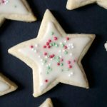 Christmas Iced Sugar Cookies, a star-shaped sweet treat for kids and grown-ups alike. Great as homemade edible gifts for families and friends this festive season, these cookies are so easy to make, and the icing only requires 2 ingredients. You can decorate them with any sprinkles you like, or even use food colouring for your icing to get different colours. Any cookie shapes can be used, and you get the best homemade Christmas cookies. #sugarcookies, #christmascookies, #icedcookies, #christmas