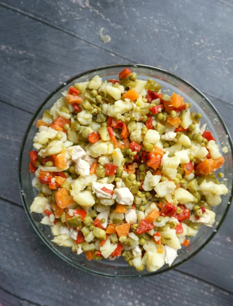 Overhead shoot of a bowl with Russian Potato Salad (Olivier  Salad) without mayo