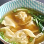 A delicious homemade wonton soup made from scratch with a filling of shrimp/prawn and pork in a flavourful chicken broth, this is comfort food at its best; Asian style. Quick and easy to make, with delicious dumplings that take only minutes to make, this soup is ideal for a busy midweek dinner, and it's better than any Chinese take-away. Ready in just 15 minutes, this is a fantastic recipe for the Chinese New Year #wontonsoup, #chinesenewyear, #dumplings, #chinesefood, #comfortfood, #healthyfood