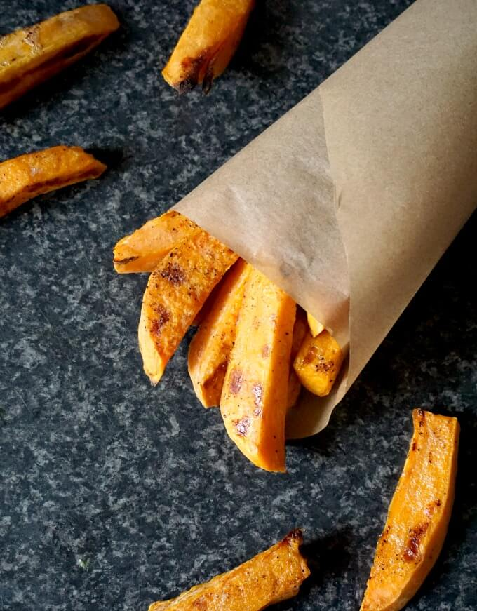 Overhead shot of a brown bag of cripsy baked sweet potato fries
