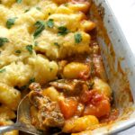 A dish of beef hot pot with cheesy gnocchi