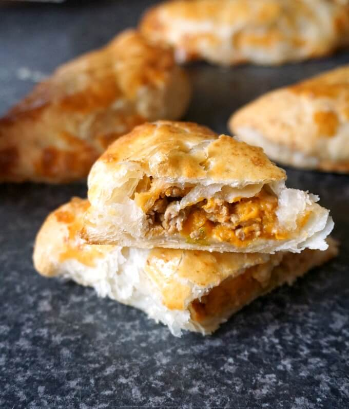 A stack of beef empanadas with sweet potatoes