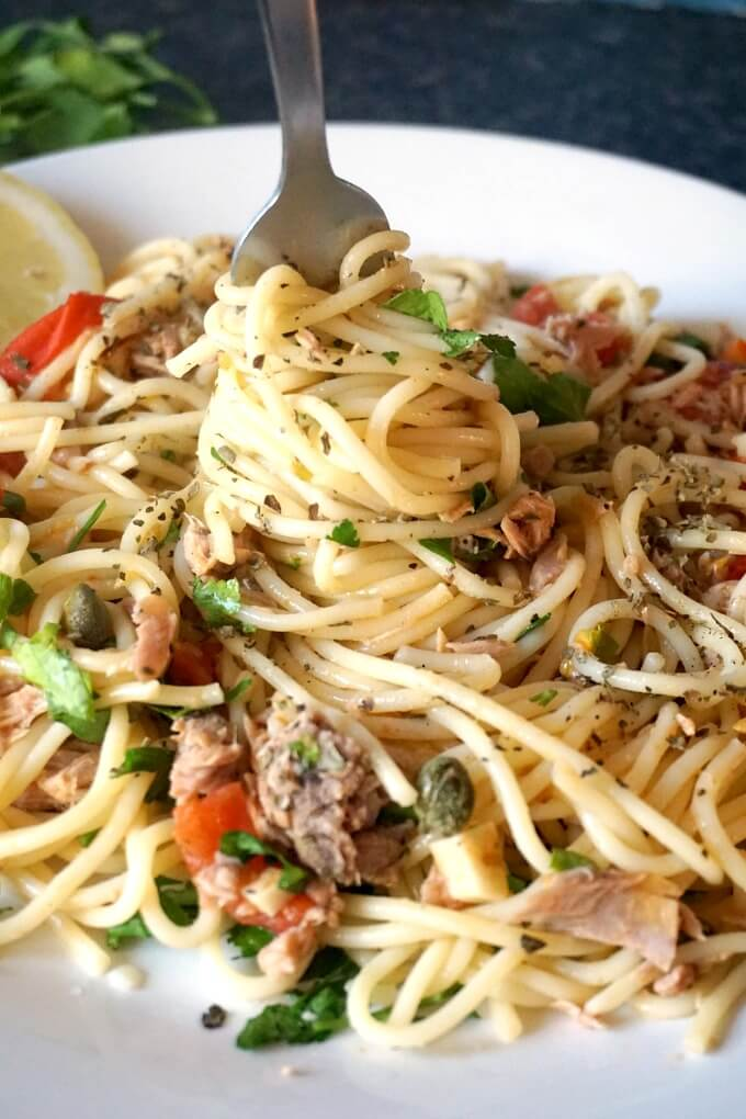 A plate of tuna spaghetti with a fork in it