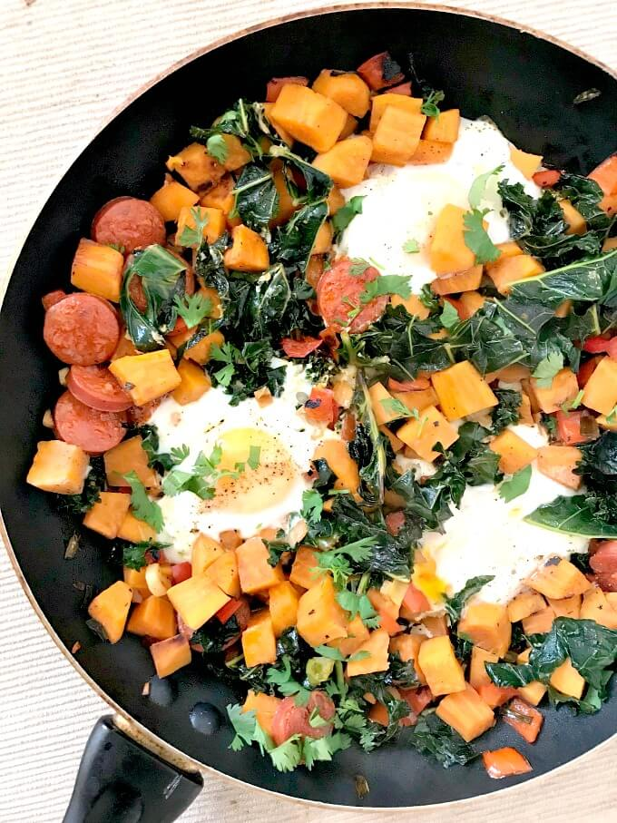 Overhead shoot of a pan of breakfast sweet potato hash with eggs