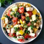 Overhead shoot of a white plate with healthy mediterranan chickpea salad with feta