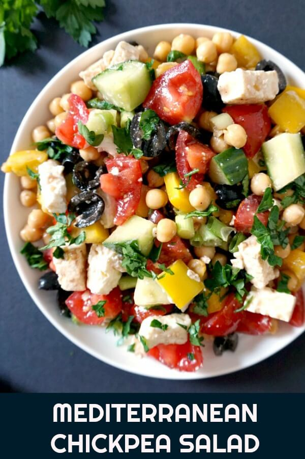 Mediterranean Chickpea Salad with Feta, a healthy salad for any season. It has a light dressing that gives the ingredients a boost of freshness and extra taste. Low carb, vegetarian, great for the whole family, this easy salad can be made in under 5 minutes. The perfect side to go with your Bbq or roast.