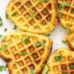 Cornbread Waffles made from scratch with bacon and cheddar cheese, a savoury twist on the classic waffle reipe. These cornmeal waffles are healthy and delicious, and they make a fantastic Fall breakfast or brunch. Crispy on the outsise, but fluffy on the inside, the waffles are a big hit with the whole family this Thanksgiving. Ready in under 30 minutes, and so easy to make, my cornbread muffins can be topped with your favourite chili too. #cornbreadwaffles, #waffles, #fallrecipes, #thanksgiving