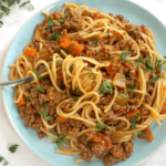A light blue plate with easy spaghetti bolognese