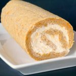 Pumpkin Roll with Cream Cheese Filling on a white plate