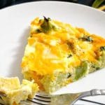 Crustless Broccoli and Cheese Quiche, a healthy recipe that is ready in about 30 minutes. Low carb, keto and gluten free, this quiche caters for all tastes. It's also kid-friendly recipe. It can be served fro brunch, lunch or dinner, either on it's own or as a side dish for roast. It's healthy, it's easy to make, and really delicious, and looks a lot like a fritatta too. A great recipe for breakfast and brunch too. #crustlessquiche, #breakfast, #brunch, #begetarianquiche