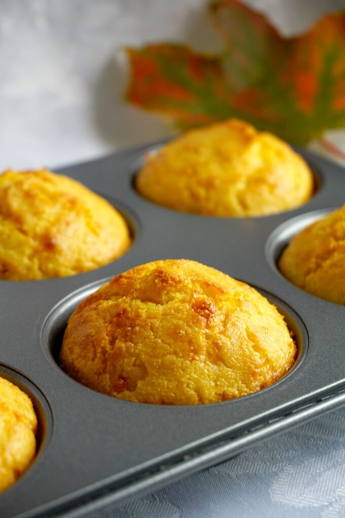 A muffin tin with 6 cornbread muffins