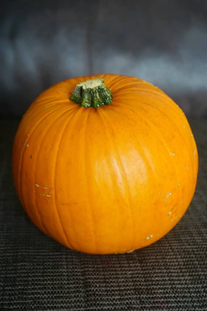 A pumpkin to be roasted for Jack-O'-Lantern Pumpkin Hand Pies