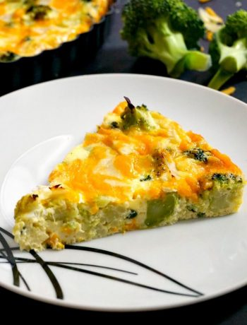 A slice of low carb crustless broccoli and cheese quiche on a white plate
