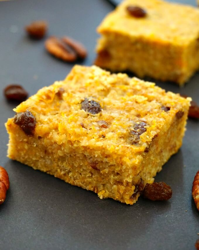 A pumpkin oatmeal bar with raisins and pecans around it