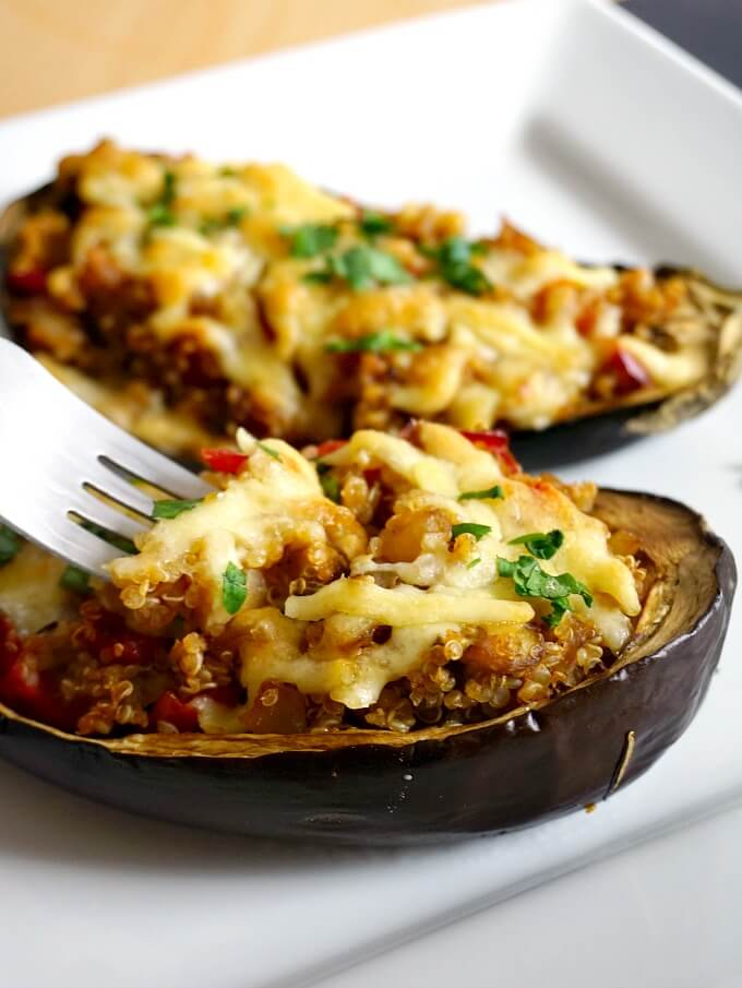 2 quinoa-stuffed eggplant on a white plate