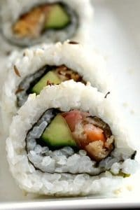 Shrimp Tempura Roll, or the best homemade sushi recipe. Quick and easy to make, these low-calorie bites are the perfect party food for every occasion. The crispy fried shrimp tempura is paired with avocado and pickled ginger in a fanstastic rice roll that is then served with a light Asian sauce. I'll show you how to make a healthy appetizer that will impress all your guests. #homemadesushi, #shrimptempura, #appetizer, #healthyappetizer, #japanesefood